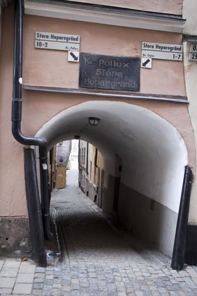 Picture of Gamla Stan (Sweden): Arch giving access to one of the many cobble-stoned alleys in Gamla Stan