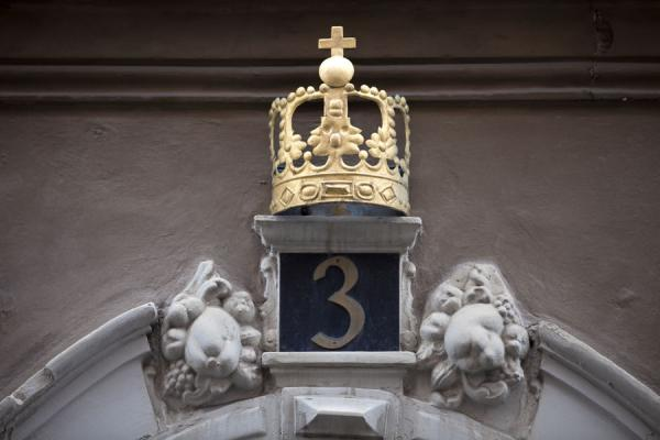 Golden crown over a house number | Gamla Stan | Sweden