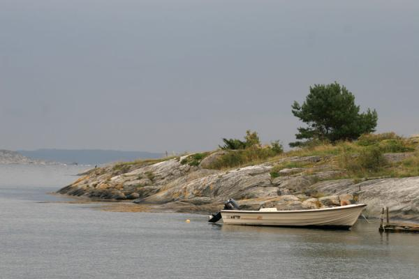 Picture of Vrångö island: boat lying in small rocky bay of Gothenburg archipelago