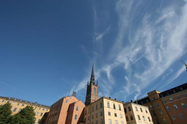 Picture of Stockholm waterfront (Sweden): Spire of Riddarholmskyrkan towering above the houses on Riddarholmen