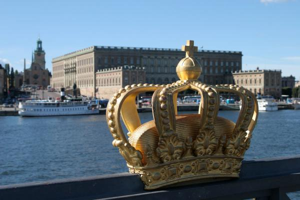 Crown on Skeppsholmsbron with Royal Palace | Stockholm waterfront | Sweden