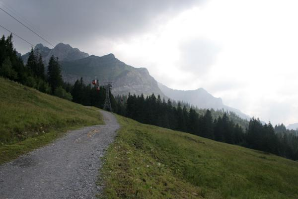 Picture of Fräkmüntegg (Switzerland): Path to Fräkmüntegg with clouds and mountains