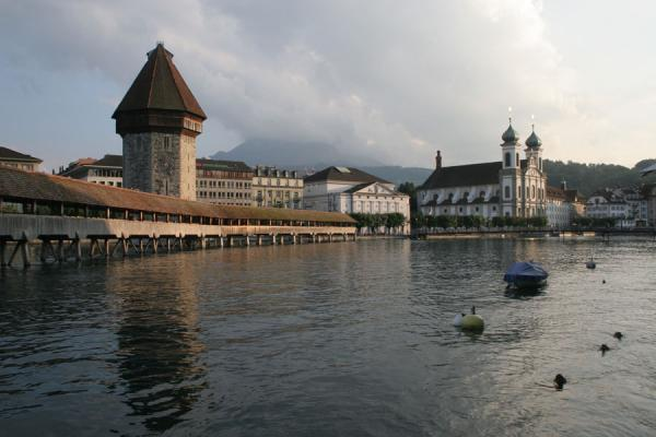 The Chapel Bridge and watchtower with the Jesuit church | Lucerne Bridges | Switzerland