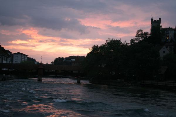 Red skies over the Speuerbrücke, the Reiss river and the contours of the old town | Lucerne Bridges | Switzerland