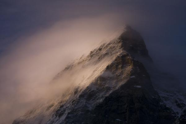 Early morning sunlight on the cloud-surrounded Matterhorn | Matterhorn Hiking | Switzerland