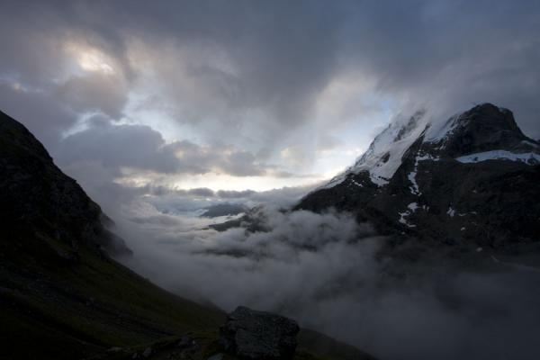 Early morning sunlight over the clouds in the Zmutt valley with the Matterhorn on the right | Matterhorn Hiking | Switzerland
