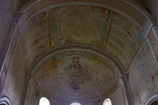 Looking up the frescoes on the ceiling of the church of Spiez | Spiez church | Switzerland
