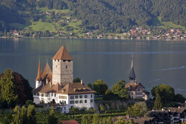 View of the castle of Spiez with the church on the right hand side | Spiez church | Switzerland