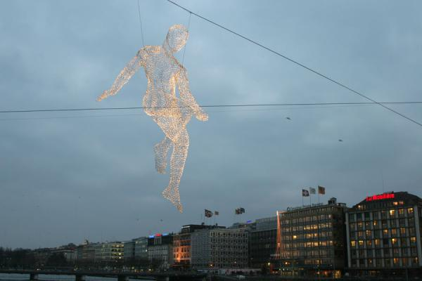 One of the voyager sculptures floating above the skyline of Geneva | Yalil Sculptures | Switzerland