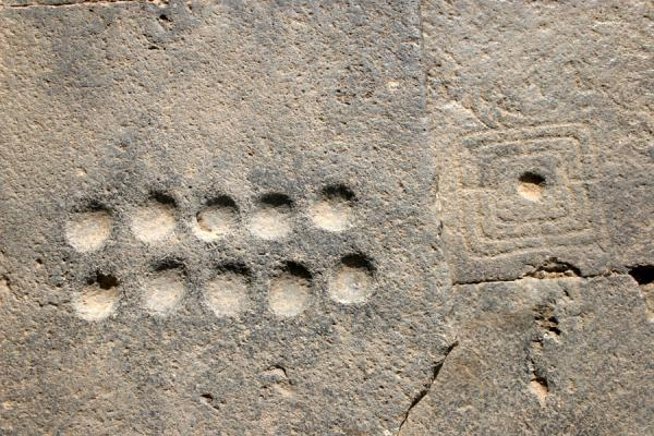 Picture of Bosra Amphitheatre (Syria): Ancient Roman games engraved in seats of the Bosra amphitheatre