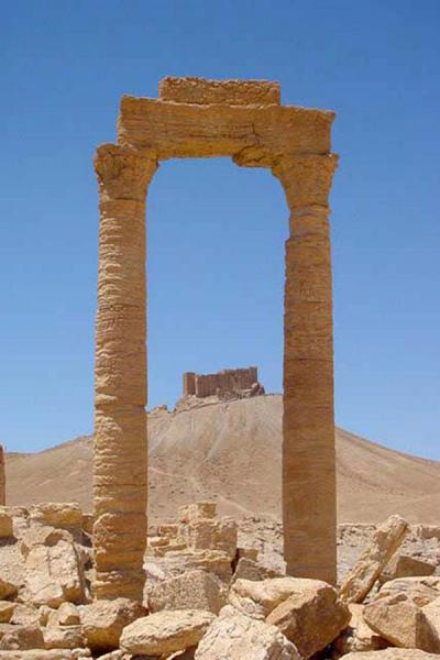 Looking at the Citadel through arches in the city | Palmyra City | Syria