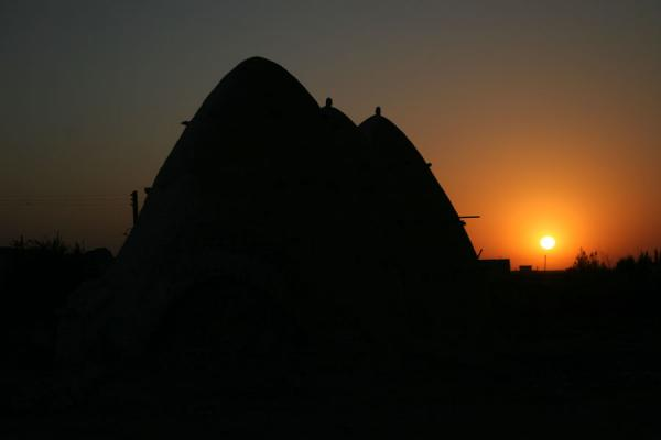 Picture of Beehive houses (Syria): Beehive houses and sunset at Sarouj