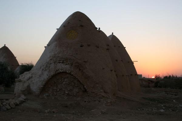 Picture of Beehive houses (Syria): Sunset behind some of the beehive houses of Sarouj