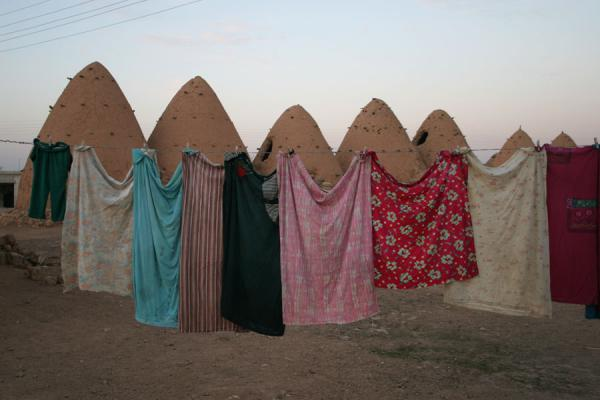 Picture of Beehive houses (Syria): Tops of beehive houses and laundry in the foreground