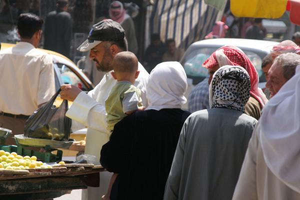 Picture of Syrian people (Syria): Young streetvendor selling fruits in the streets of Deir es Zor