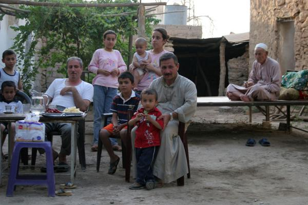 Picture of Syrian people (Syria): Friendly Syrian family posing for a picture after an afternoon tea