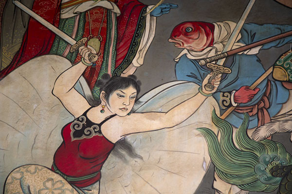 Detail of a fierce female fighter on the back wall of Baoan temple | Dalongdong Baoan temple | Taiwan