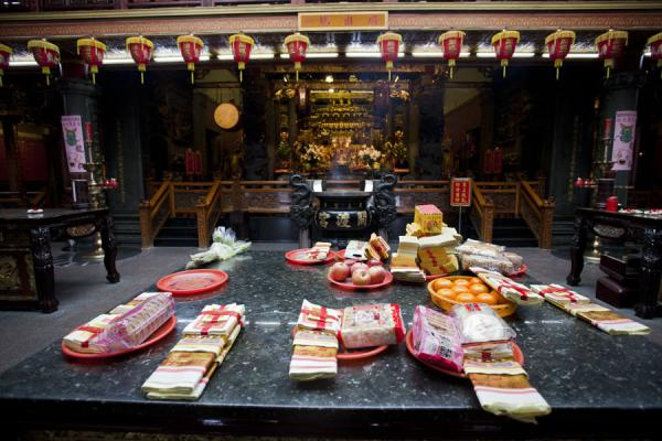 Picture of Guandu temple (Taiwan): Spirit money, biscuits, and fruits left as offerings in Guandu temple