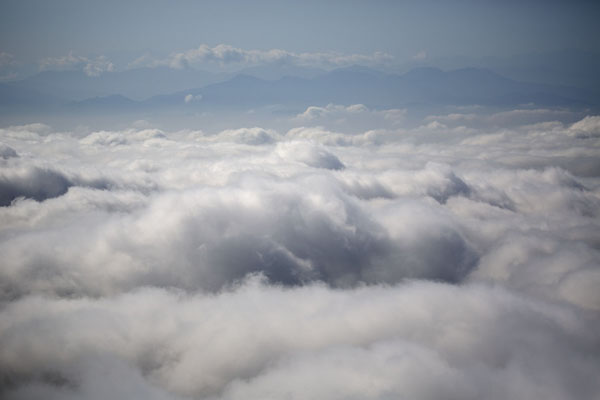 Looking over the clouds with mountains in the distance - 台湾