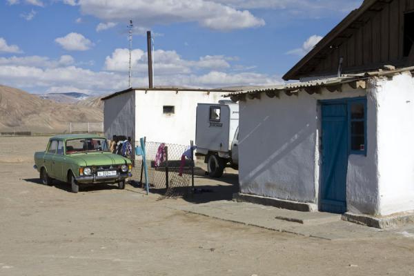 Whitewashed houses and old car in Bulunkul | Bulunkul | Tajikistan