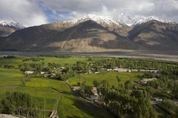 Picture of Green valley and rugged mountains with snow seen from the Buddhist stupa of Vrang