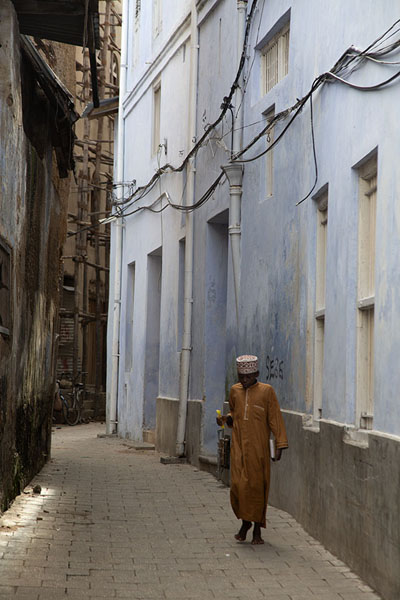 Foto di Boy walking an alley of Stone TownZanzibar City - Tanzania