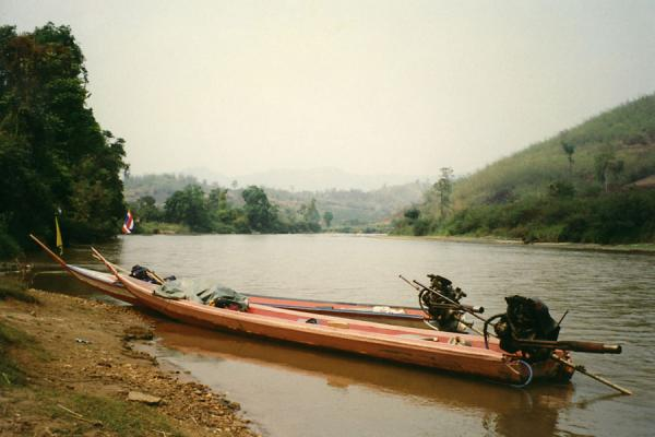 Picture of Chiang Rai river tour (Thailand): Long-tail boats on a river near Chiang Rai