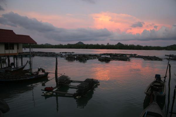 Picture of Ko Panyi (Thailand): Ko Panyi: pink, red and grey lights of sunset reflected in the waters