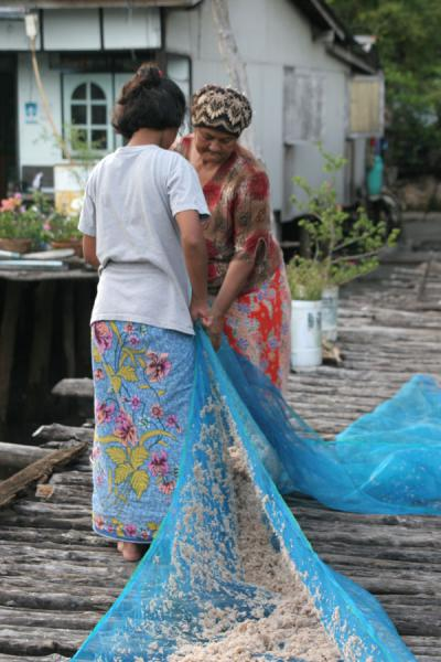 Women cleaning the nets after fishing in Ko Panyi | Ko Panyi | Thailand