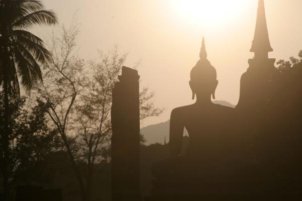 Picture of Sukhothai (Thailand): Wat Mahathat near sunset: Buddha silhouet at Sukhothai