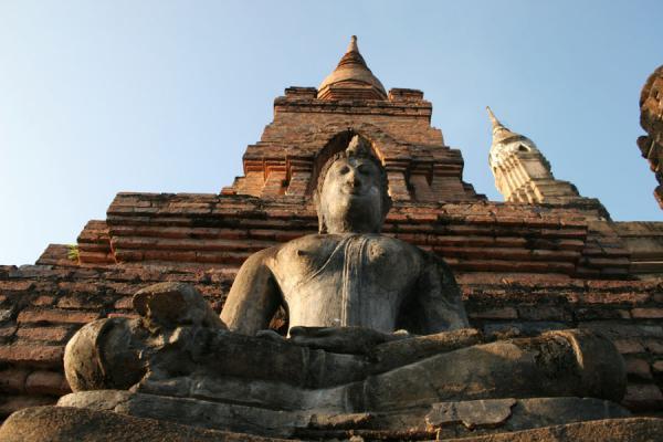 Picture of Sukhothai (Thailand): Buddha and main stupa seen from below at Wat Mahathat at Sukhothai