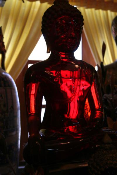 Picture of Wat Khao Sukim (Thailand): Wat Khao Sukim: transparent red Buddha