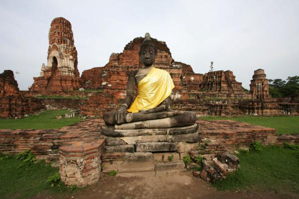 Picture of Wat Phra Mahathat (Thailand): Wat Phra Wahathat with Buddha statue and yellow cloth around shoulder