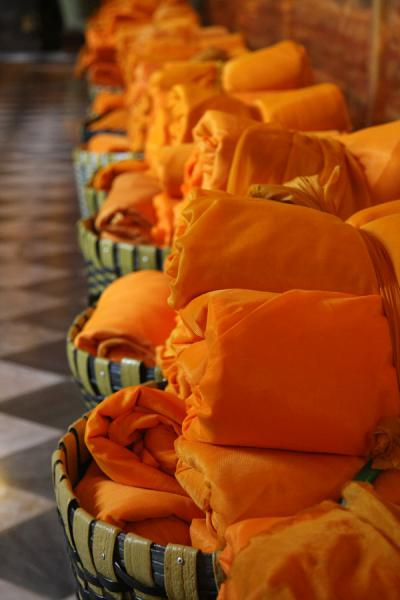 Picture of Wat Phanan Choeng (Thailand): Baskets with orange robes to be used by worshippers