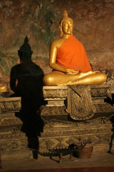 Golden Buddha wrapped in orange cloth inside Wat Tham Suwannakuha | Wat Tham Suwannakuha | Thailand