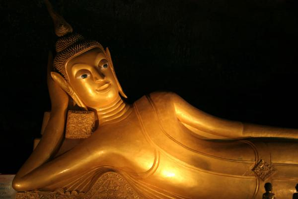 Part of the giant reclining golden Buddha | Wat Tham Suwannakuha | Thailand