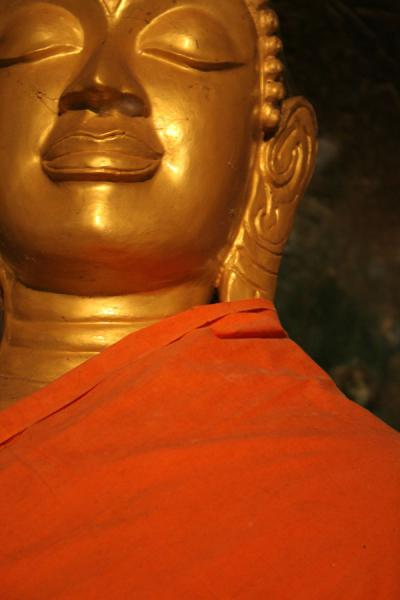 Close-up of Buddha wrapped in orange cloth | Wat Tham Suwannakuha | Thailand