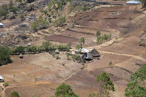 Looking down at one of the traditional houses on the road to Hatobuilico | Mount Ramelau | Timor-Leste