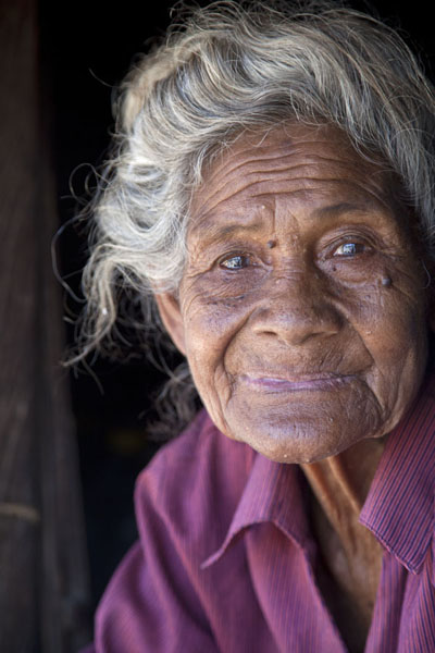 Picture of Old woman or abu sitting in her hutSuai Loro - Timor-Leste