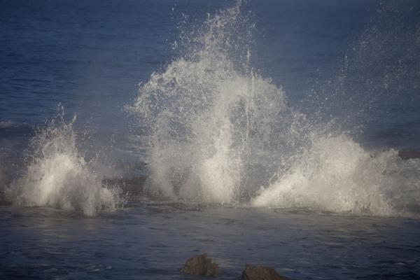 Foto van Spray of water caused by blowholes on the western coast of 'Eua island - Tonga - Oceanië