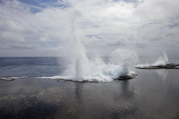 Picture of Strong waves and high tide cause the water to be sent high up into the sky - Tonga - Oceania