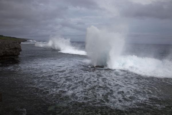 Several blowholes in a row causing a temporary fountain of water into the air | Mapu a Vaea Blowholes | Tonga