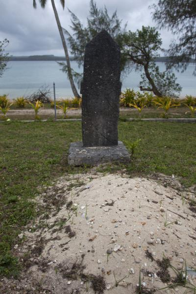 Picture of Tongan cemeteries (Tonga): Coral tombstone at sand grave near the coast of Vava'u island