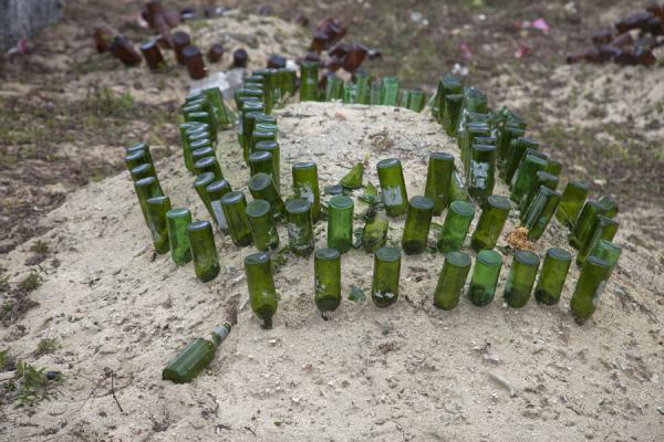 Picture of Tongan cemeteries (Tonga): Grave marked by beer bottles in Lapaha