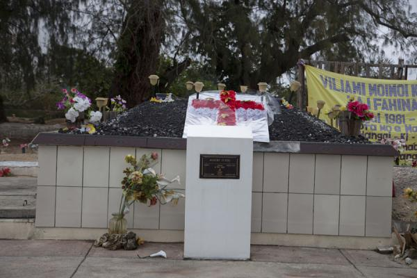 Picture of Tongan cemeteries (Tonga): This more official grave also has sand and fake flowers on top