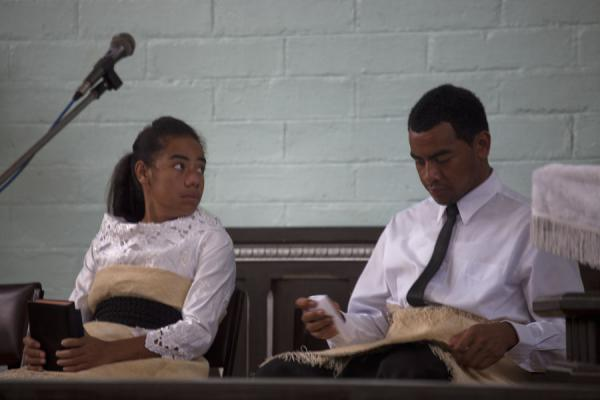 Picture of Tongan church services (Tonga): Woman and man dressed in white leading a church service in Neiafu
