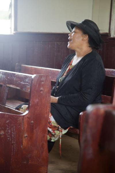 Picture of Tongan church services (Tonga): Dressed in black and singing along in a church service on 'Eua island
