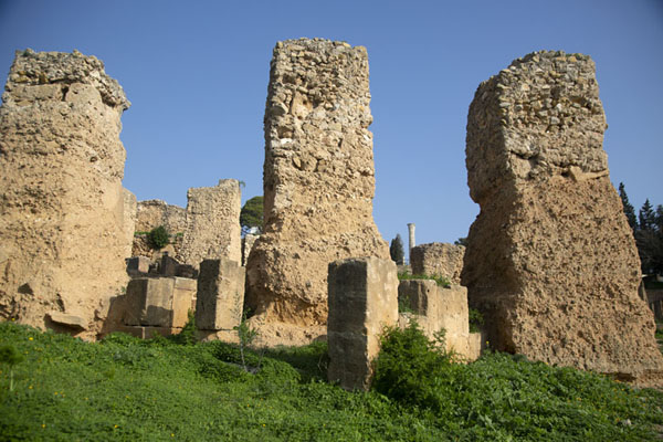 Looking up the Roman wall with remains of Punic-era house in the foreground | Punic Carthage | Tunisia