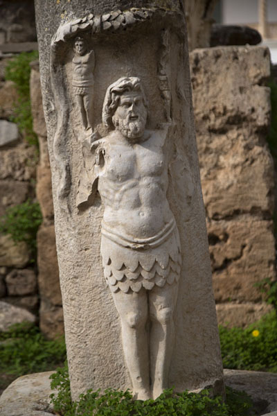 Detailed view of a sculpted figure in the judicial basilica | Carthage romaine | Tunisie