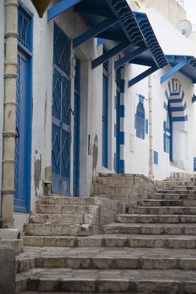 Empty street in Sousse with blue doors and whitewashed walls | Sousse medina | Tunisia